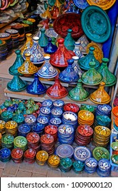 A display of traditioal decorated pottery In the Souk the Street Market at Jemaa el Fnaa in the Medina Old City in the centre of Marrakech in Morocco. The Souk is enjoyed by visitors and tourists.