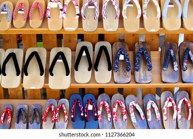 Display of traditional wooden sandals and Japanese slippers in local shoe store, Japan