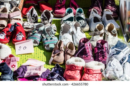 display of used girl baby and child shoes for charity,donating,reusing or reselling for second life sold at garage sale at springtime