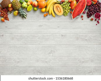Display of various of fresh fruits on white table