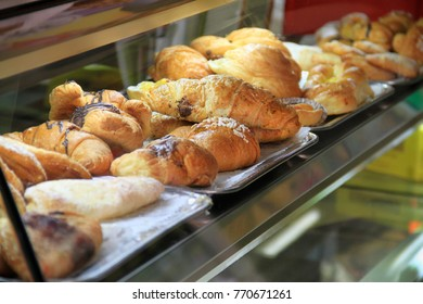 Display window with pastry - croissant in showcase.