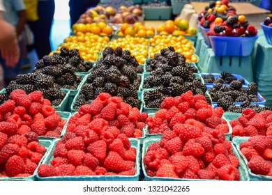 Displayed with care and pride, delicious premium fresh berries and cherries are plentiful during summer at the Granville Island Market in Vancouver, Canada.