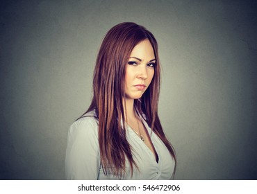Displeased angry pessimistic woman with bad attitude looking at you. Negative human emotion