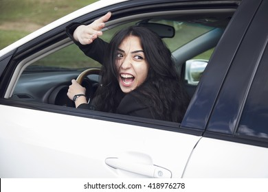 displeased, angry woman driving the car