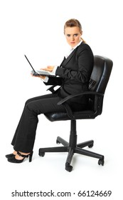 Displeased business woman sitting on chair and holding laptop in hand