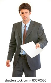 Displeased modern businessman showing document  isolated on white