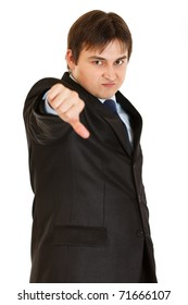 Displeased modern businessman showing thumbs down gesture isolated on white