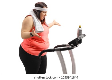 Displeased overweight woman on a treadmill isolated on white background