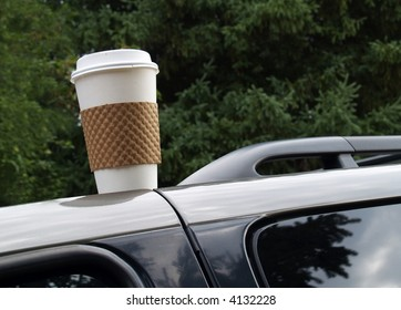 disposable coffee cup left on top of a vehicle