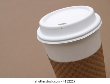 disposable coffee cup with protective cardboard holder