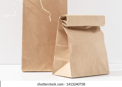 Disposable, compostable, recyclable paper eco bags with over white background. Close up.