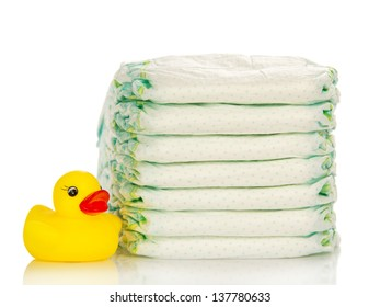 Disposable diapers and the rubber duckling, isolated on white
