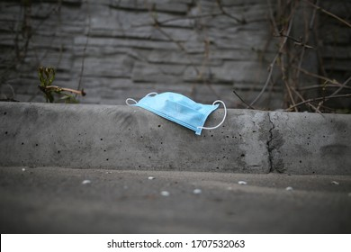Disposable face mask. Surgical masks are used carelessly scattered on the street. Do not throw away your used face mask.