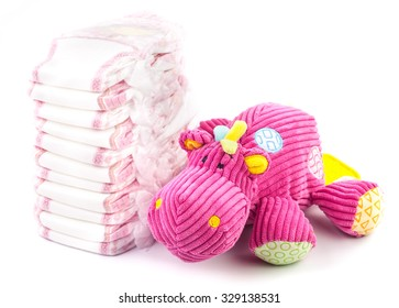 Disposable nappies and soft toy