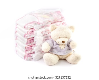 Disposable nappies and teddy bear
