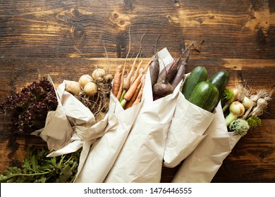 Disposable paper ecological packaging for vegetables. Fresh organic products and waste free lifestyle.