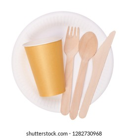 Disposable paper plate and cup and wooden cutlery isolated on white background