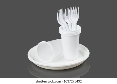 Disposable plastic plate on a gray background