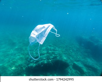 Disposable protection mask under the sea, residues of the covid-19 pandemic