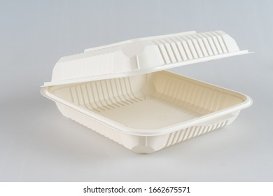 Disposable, square, plastic, white food container isolated on a white background.