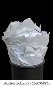 Dispose of paper in the office for modern and effective workflow presented with a full wastebasket