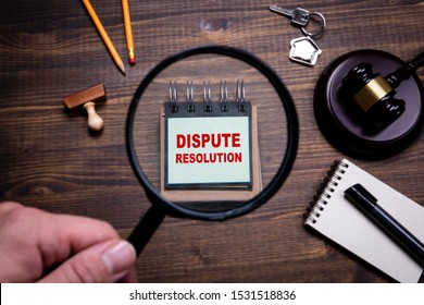 Dispute resolution. Lawyers, litigation, law and justice concept. Man's hand, holding magnifying glass