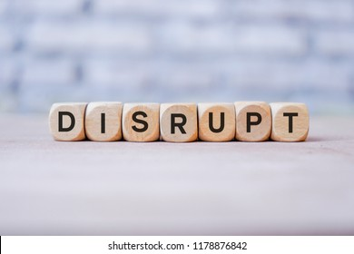 Disrupt word written on wood block