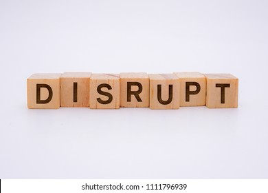 Disrupt Word Written In Wooden Cube