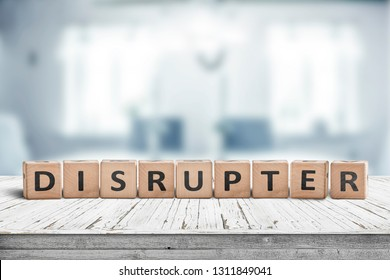 Disrupter sign on an office desk on a bright blue room in daylight