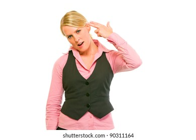 Dissatisfied modern business woman shooting herself with gun shaped hand