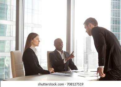 Dissatisfied unhappy with refusal job seeker threatening multinational employers. Angry client arguing with company managers or lawyers. Failed interview, partners rough behavior at business meeting