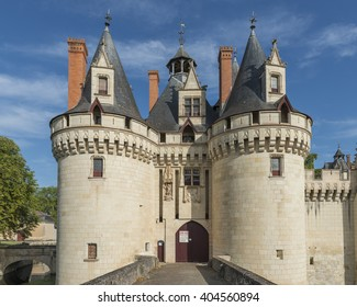 Dissay, France - August 11, 2014: Great Chateau - Castle with several towers and bridge.