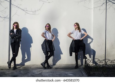Dissociative disorder, girl in black against the background of the white wall