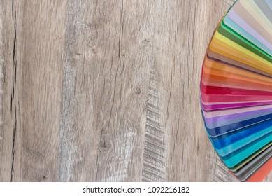 Dissolved in fan colour spectrum on wooden desk background