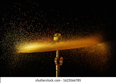 Dissolving cymbal (sand on cymbal with off camera flash gelled in red yellow and green)