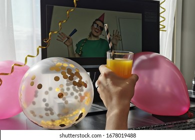 Distance birthday, love, social distancing, friendship, surprise,  quarantine, isolation, stay at home,  self-isolation concept. Birthday congratulation through the computer screen. Selective focus.