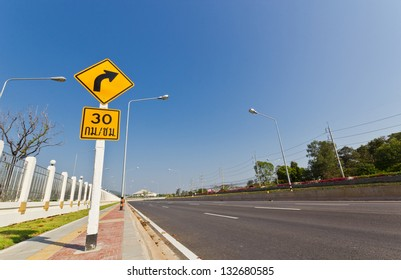 Distance Higyway Road and Traffic Sign with Background of Blue Sky in a Bright Day.