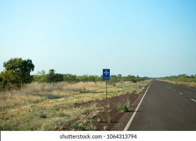 Distance marker showing a long way to medical care in the outback of the Northern Territory in Australia
