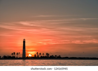 Distance view of Dry Tortugas lighthouse at dramatic sunset