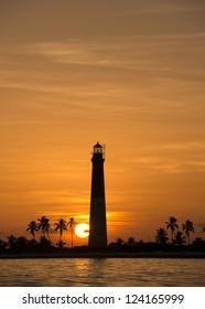 Distance view of a dry tortugas lighthouse at dawn