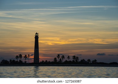 Distance view of a Dry Tortugas lighthouse at scenic sunset