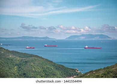 Distanced view of Cargo Ship near coastline, outdoor