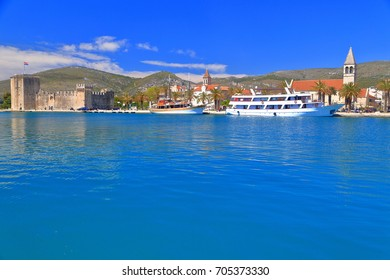 Distant boat by the pier of the historical town of Trogir, Croatia