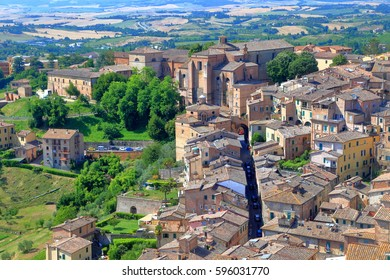 Distant church and medieval streets in Siena, region of Tuscany, Italy