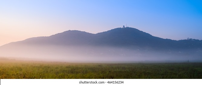 Distant hills on misty morning