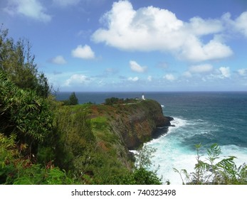Distant light house on a bluff on the north shore of Kauai, Hawaii