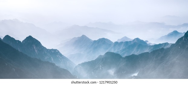 Distant mountain range in mist
