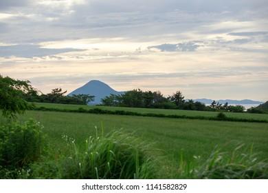 Distant mountain under beautiful sunset on Tottori coast