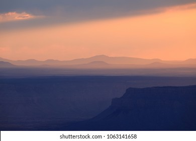 Distant mountains against the sunset sky and summer haze.  Locust Point. North Rim.  Grand Canyon National Park, Arizona