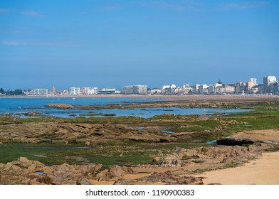 Distant panorama view of the beach rocks and cityscape of Les Sables d Olonne in Vendee France